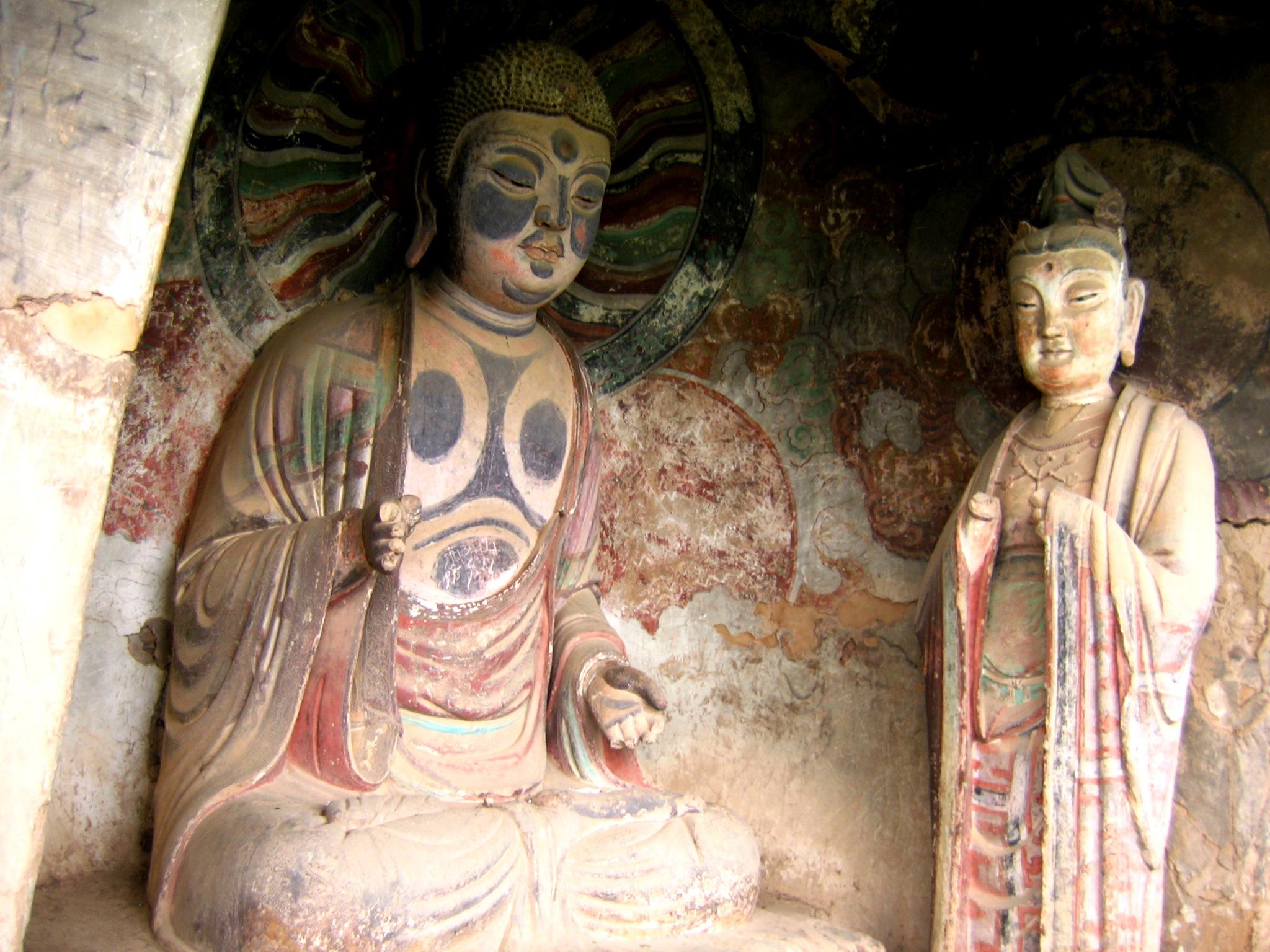 размалеванные будды